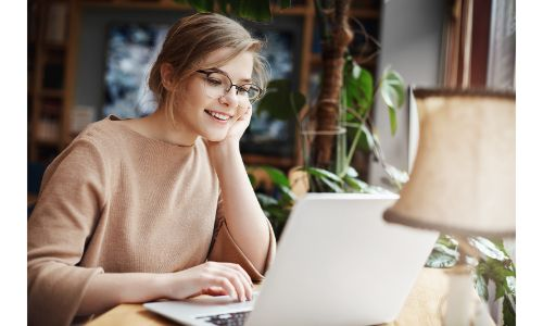 girl sitting at home with laptop computer and lamp