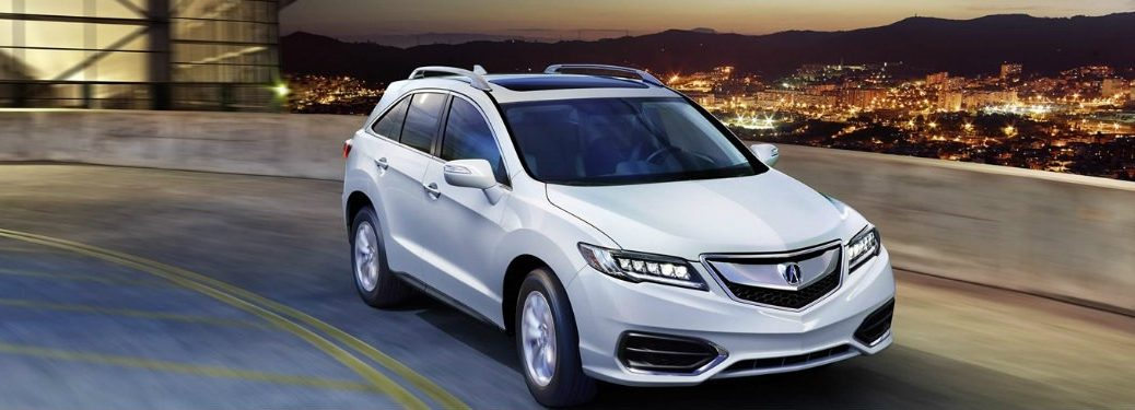 white-2018-Acura-RDX-driving-around-a-curve