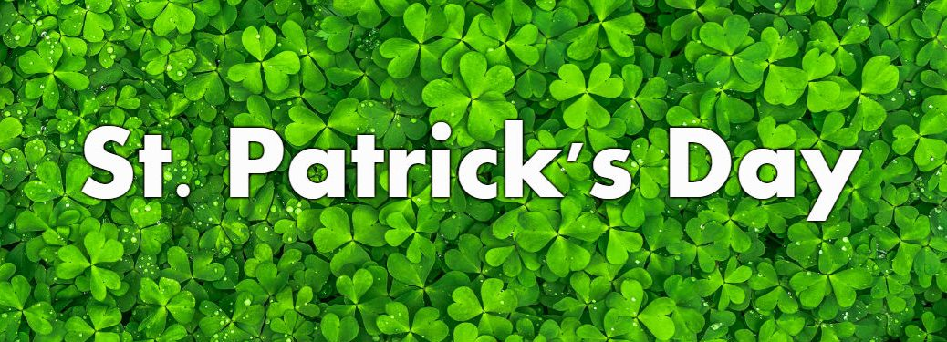 St. Patrick's Day written over four leaf clovers