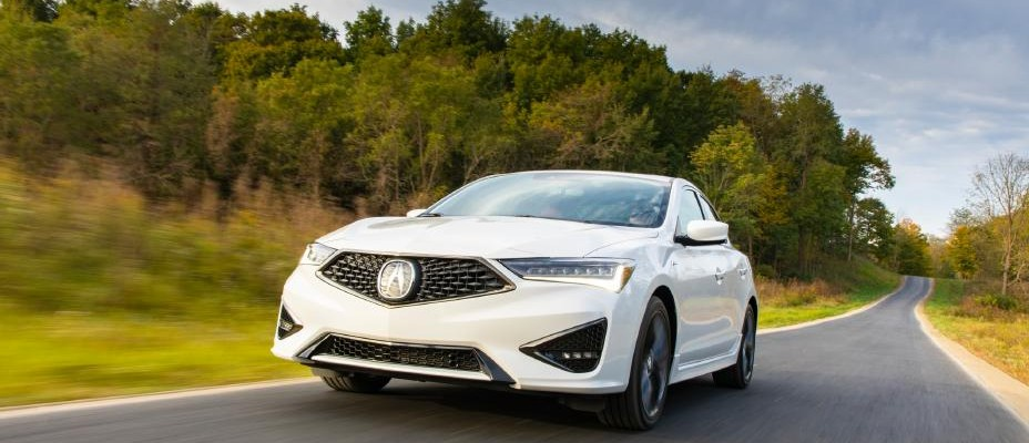 White Acura ILX driving on road