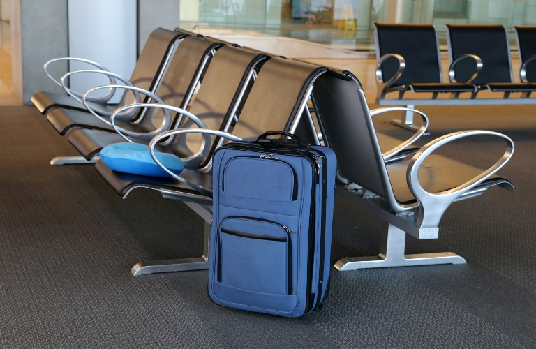 a suitcase in an airport left alone