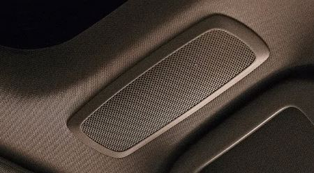 a speaker on the top of a car cabin