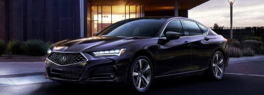 2021 Acura TLX driving down a city street