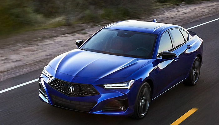 2021 Acura TLX driving down a rural road