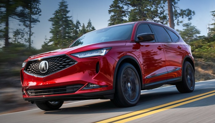 2022 Acura MDX driving down a forest road