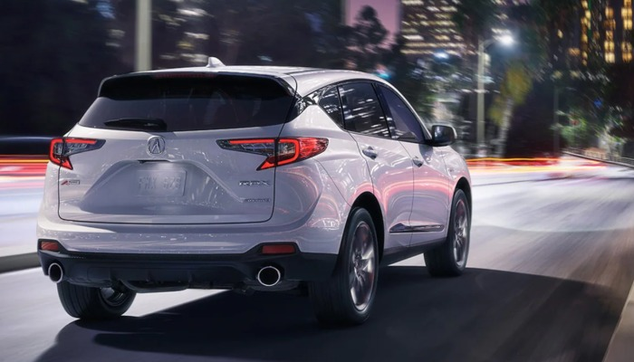 2021 Acura RDX driving down a city street at night