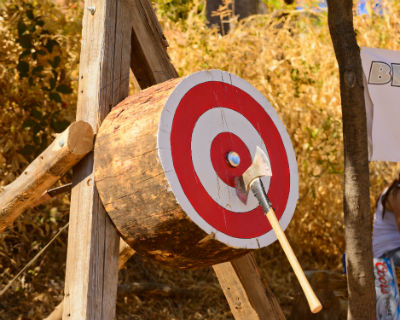 axe in red and white log target