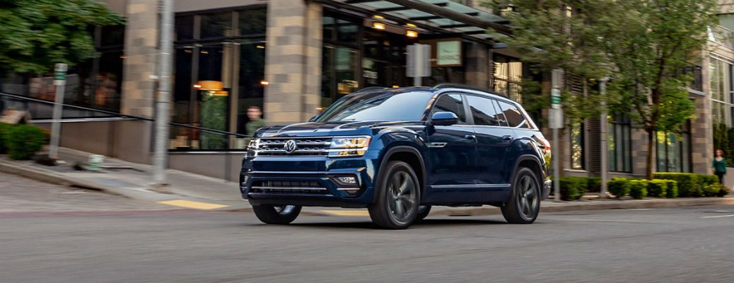 2020 VW Atlas blue exterior front fascia driver side driving in city