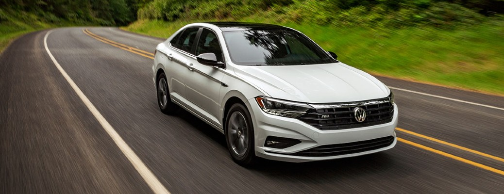 2020 VW Jetta white exterior front passenger side driving on highway