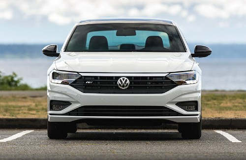 2020 VW Jetta white exterior front parked in parking lot near lake