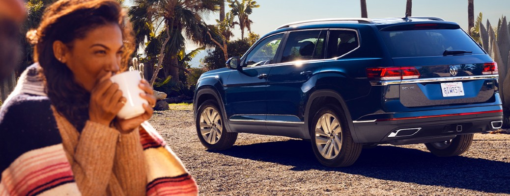 2021 VW Atlas blue exterior rear driver side parked woman drinking hot drink