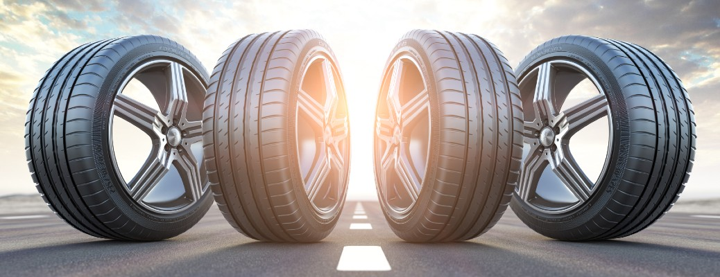four tires standing up with sun shining in background