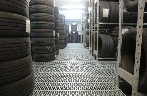 storage room with several stacks and shelves of tires
