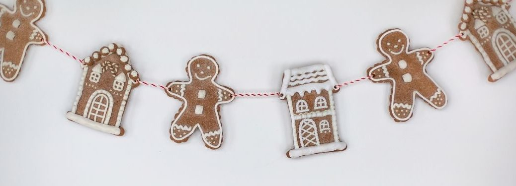 string of gingerbread cookie people and houses
