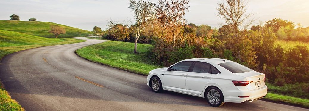 2021 VW Jetta white exterior rear fascia driving on country road