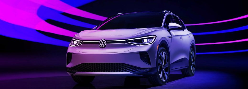 2021 VW ID4 parked in room with pink and blue lighting