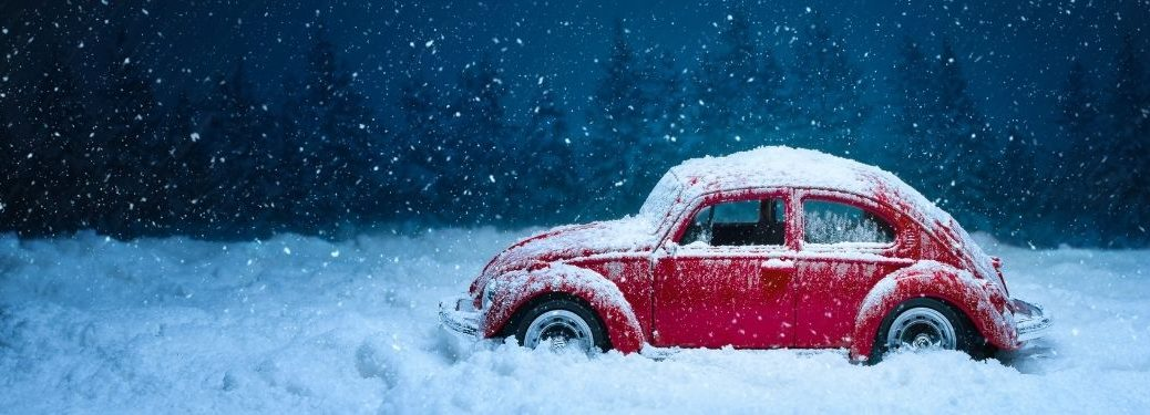 toy car red buggy stuck in snow
