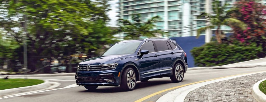 2021 VW Tiguan blue exterior front fascia driver side driving through roundabout