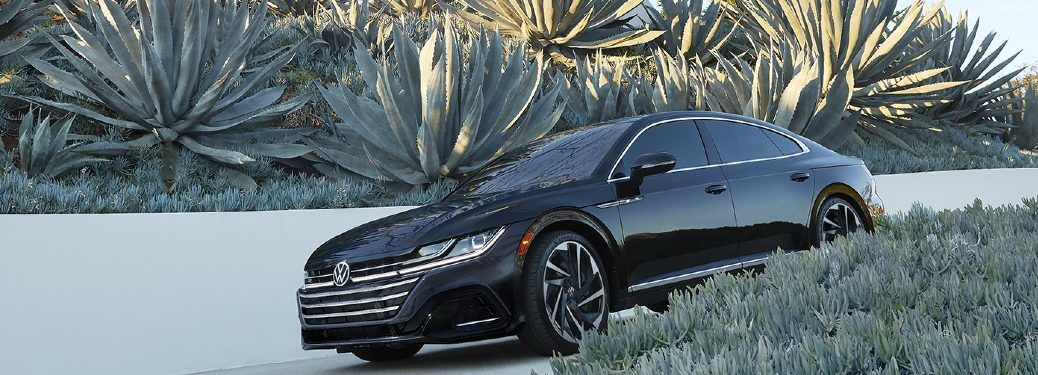 2021 VW Arteon black exterior front fascia driver side driving out of driveway