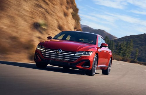 2021 VW Arteon red exterior front fascia driving on highway next to cliff