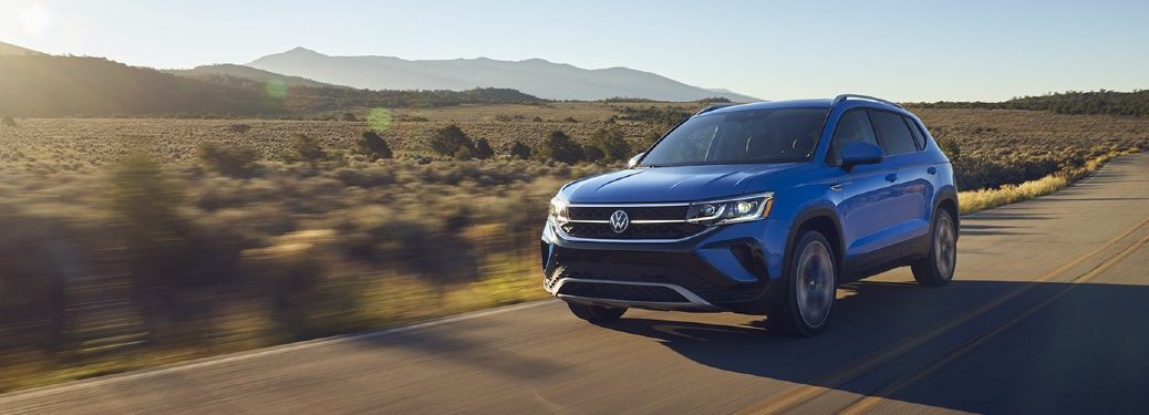 2022 VW Taos blue exterior front fascia driver side driving on desert highway
