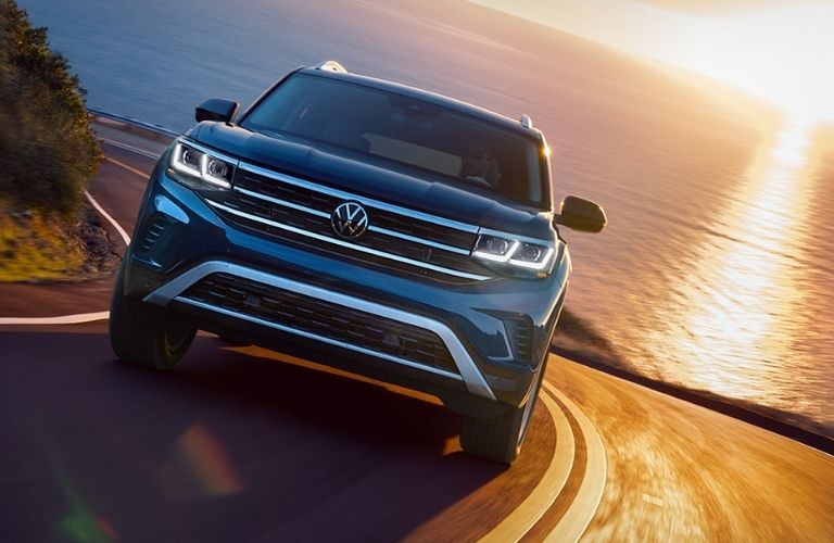 Front view of a 2022 VW Atlas driving on a beach road.