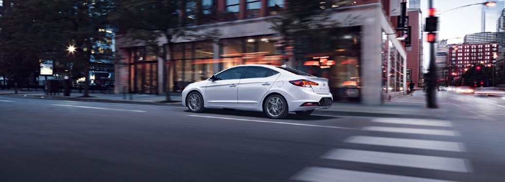 2020 Elantra driving down a city street