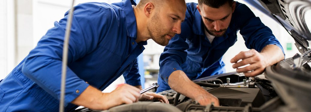 Two engineers inspecting an engine