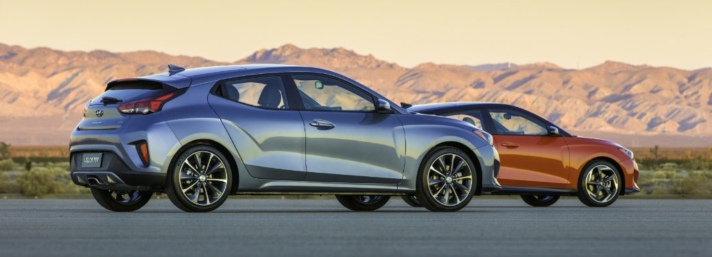 Two 2019 Hyundai Veloster models parked beside each other