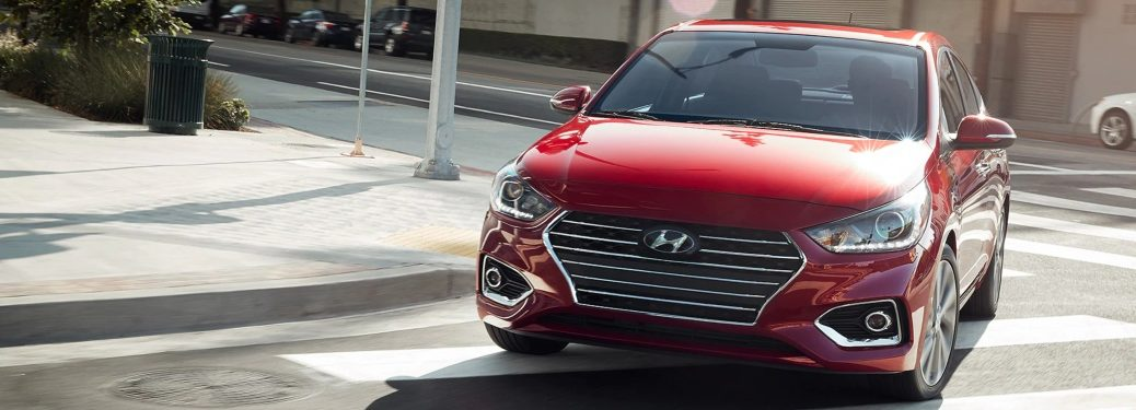 Red 2019 Hyundai Accent taking a right turn