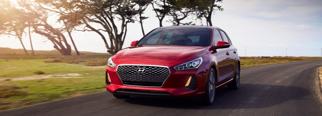 Red 2018 Hyundai Elantra GT driving at sunset