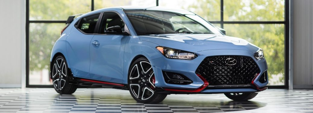 2019 Hyundai Veloster N blue front view on a checkered flag floor