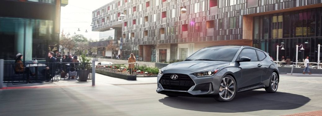 2020 Hyundai Veloster rounding a corner in the city