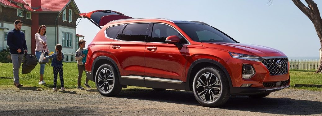 2020 Hyundai Santa Fe cargo hold being loaded by a family