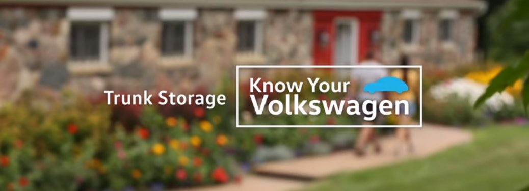 "tet that says ""Trunk Storage Know Your Volkswagen"" over blurred image of a farm house"