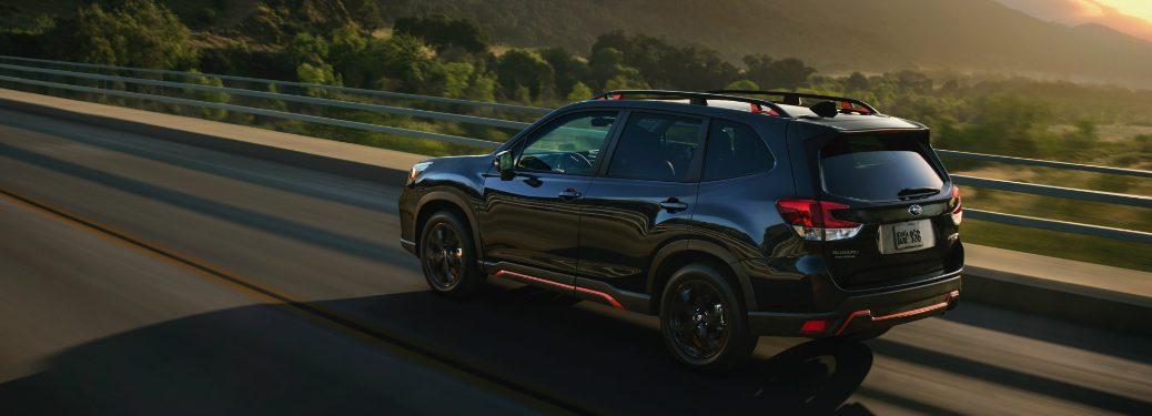 2019 subaru forester sport trim driving at sunset