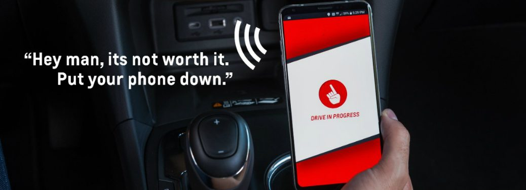 "view of Chevy Call Me Out app with text that says, ""Hey man, it's not worth it. Put your phone down."""