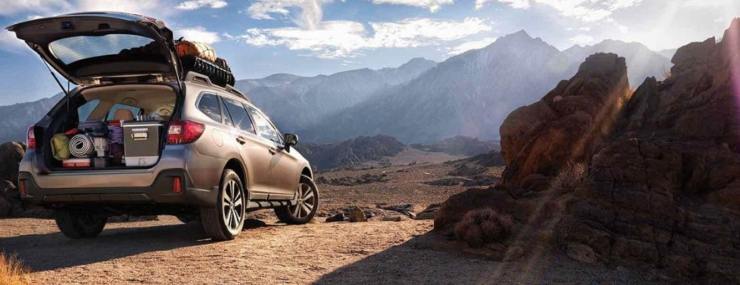 2019 Subaru Outback with Lifgate Open in Front of Mountains