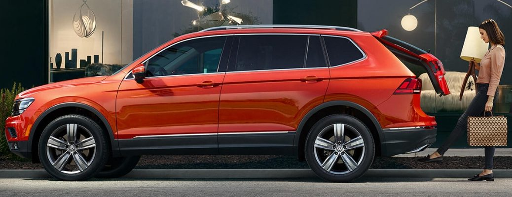 Side View of Red 2019 Volkswagen Tiguan with Woman at the Rear