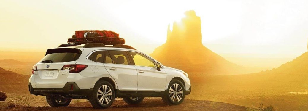 2019 Subaru Outback parked in a desert at sunset