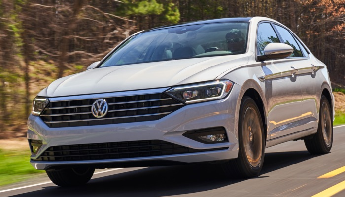 2019 Volkswagen Jetta driving down a forest road