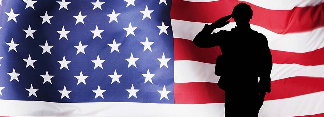 A silhouette of a man salutes over an American flag background