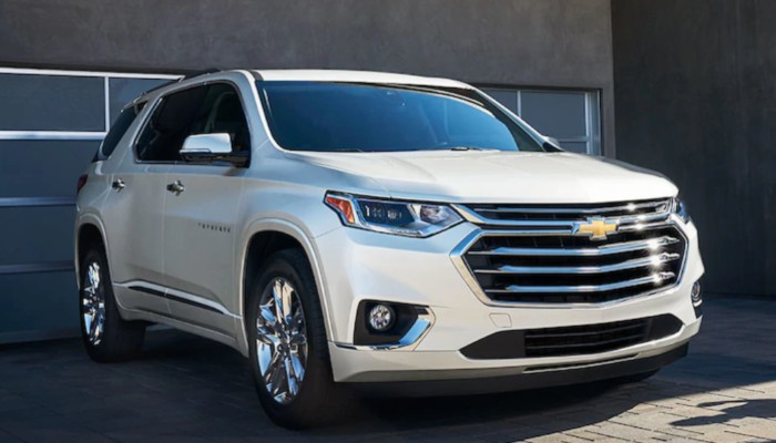 2019 Chevy Traverse parked in front of a building