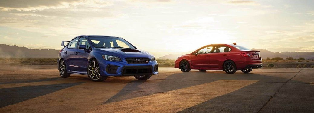 Two 2019 Subaru WRX models parked at sunset