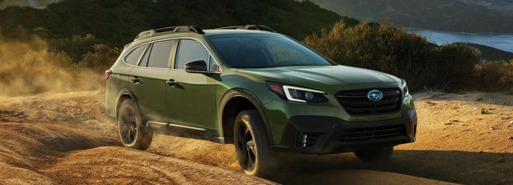 2020 Subaru Outback driving on a dirt trail