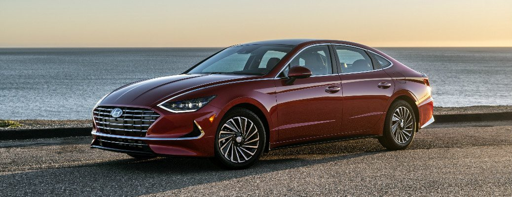 Maroon 2020 Hyundai Sonata Hybrid parked near the ocean