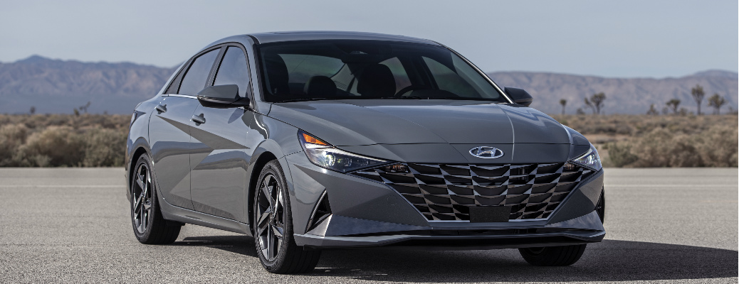 Passenger's side front angle view of grey 2021 Hyundai Elantra Hybrid