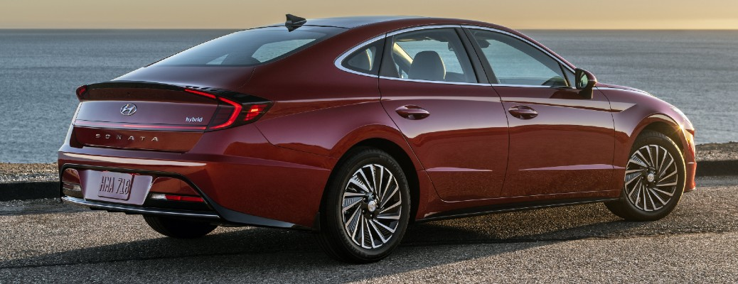 Passenger's side rear angle view of maroon 2020 Hyundai Sonata Hybrid