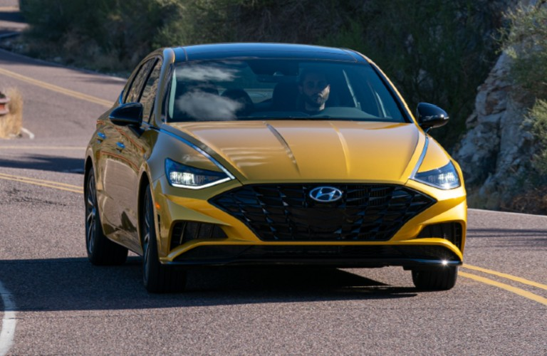 Yellow 2020 Hyundai Sonata driving on a curvy road