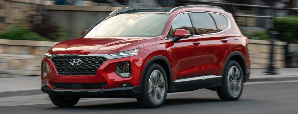 Driver's side front angle view of red 2020 Hyundai Santa Fe